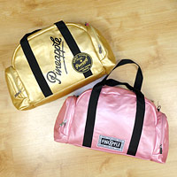 Pink Pineapple Dance Bag and Gold Pineapple Dance bag with Pineapple branding.