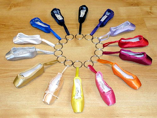 Miniature pointe shoe keyrings.