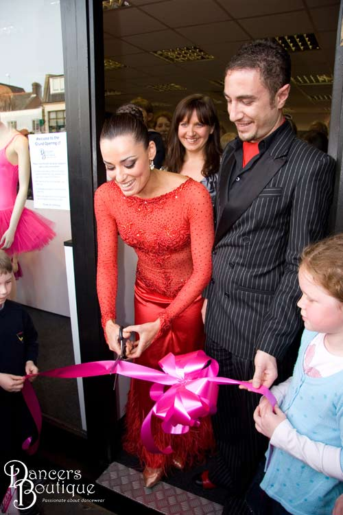 Lucy and Kieran hold the ribbon for Flavia. Dancers Boutique is officially opened